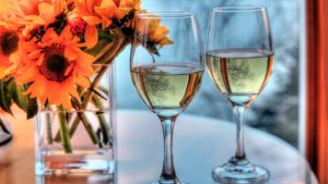 Bluefin Bay Wine Glasses and Flowers in Room