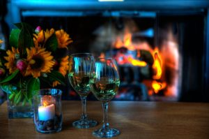 Fire in fireplace and Wine Glasses
