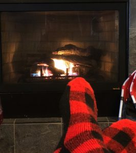feet by the fireplace at bluefin bay