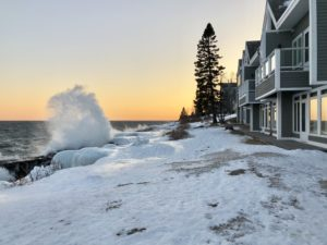 winter waves and sunset at bluefin bay