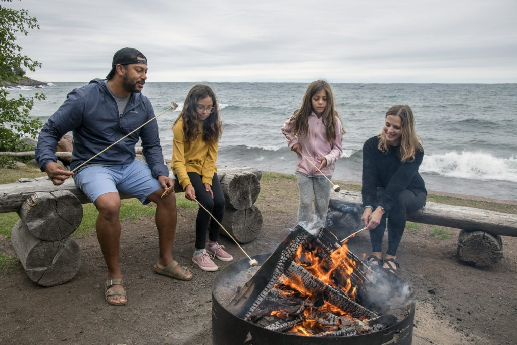 Family at the Bonfire Pit with Waves